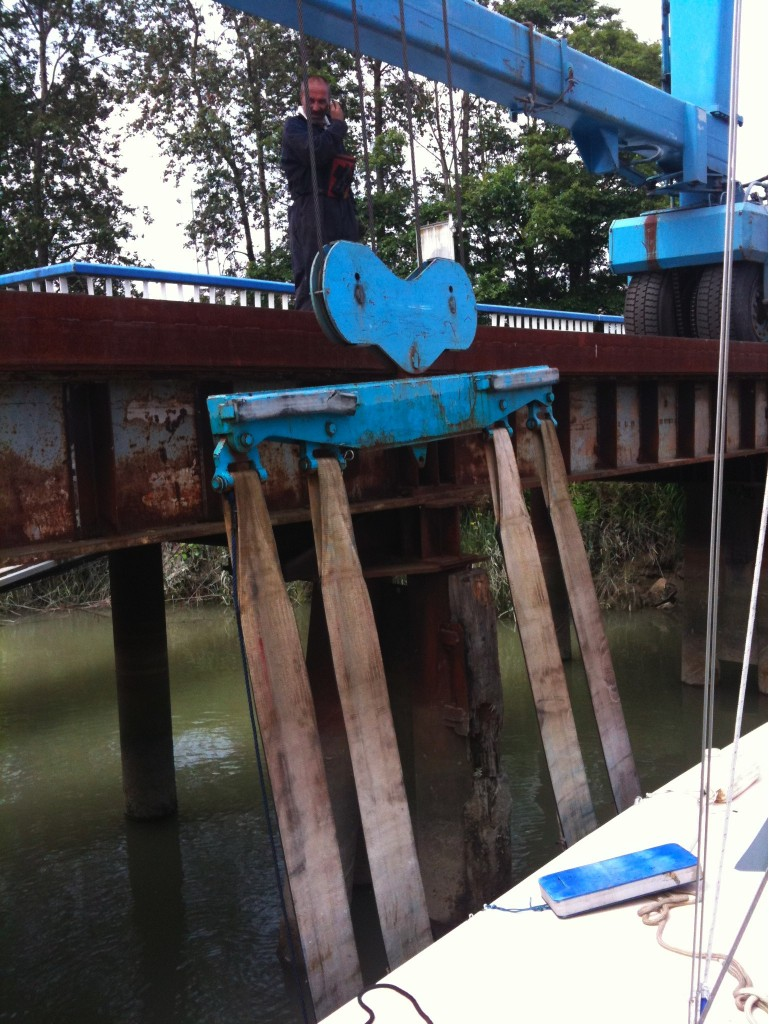travelift lifting Tie Fighter out of the water