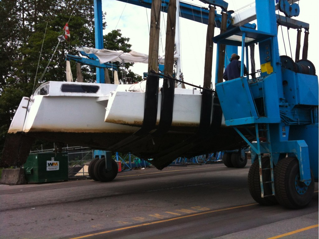 carrying Tie Fighter across the boatyard