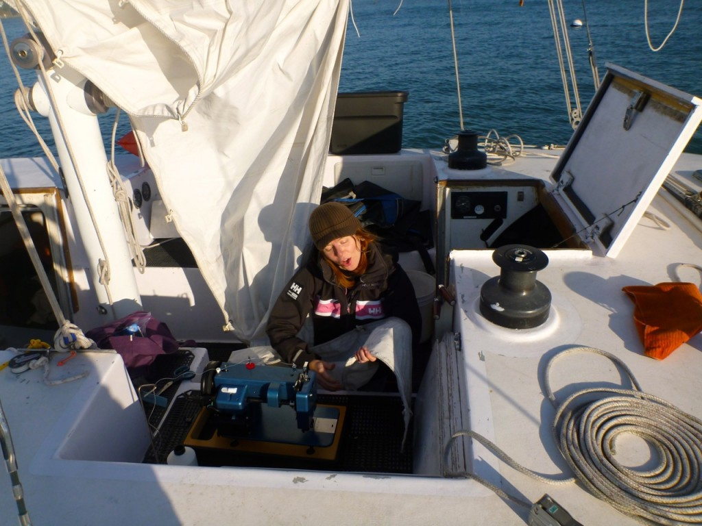 Miya sewing the headsail