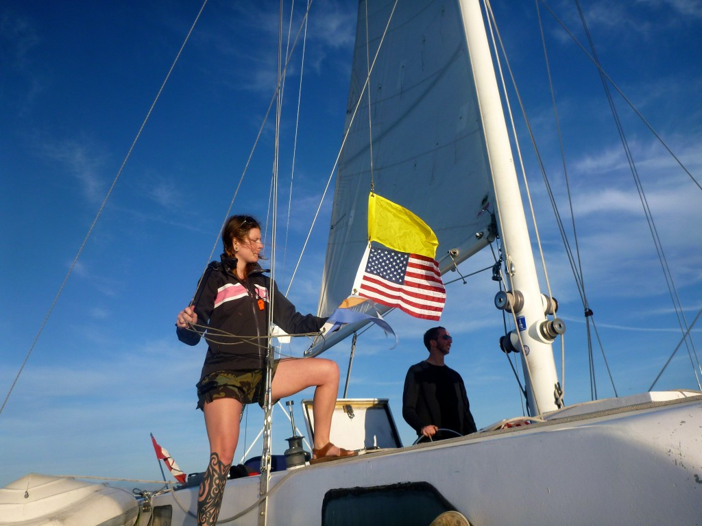 Miya hoisting the yellow quarantine flag prior to crossing the border